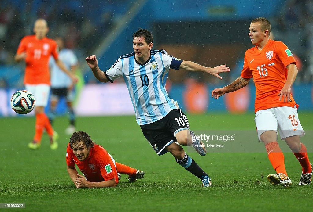 <a gi-track='captionPersonalityLinkClicked' href=/galleries/search?phrase=Lionel+Messi&family=editorial&specificpeople=453305 ng-click='$event.stopPropagation()'>Lionel Messi</a> of Argentina controls the ball as <a gi-track='captionPersonalityLinkClicked' href=/galleries/search?phrase=Jordy+Clasie&family=editorial&specificpeople=7012011 ng-click='$event.stopPropagation()'>Jordy Clasie</a> of the Netherlands gives chase during the 2014 FIFA World Cup Brazil Semi Final match between the Netherlands and Argentina at Arena de Sao Paulo on July 9, 2014 in Sao Paulo, Brazil.