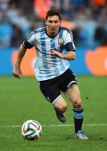 Lionel Messi of Argentina controls the ball during the 2014 FIFA World Cup Brazil Semi Final match between the Netherlands and Argentina at Arena de...