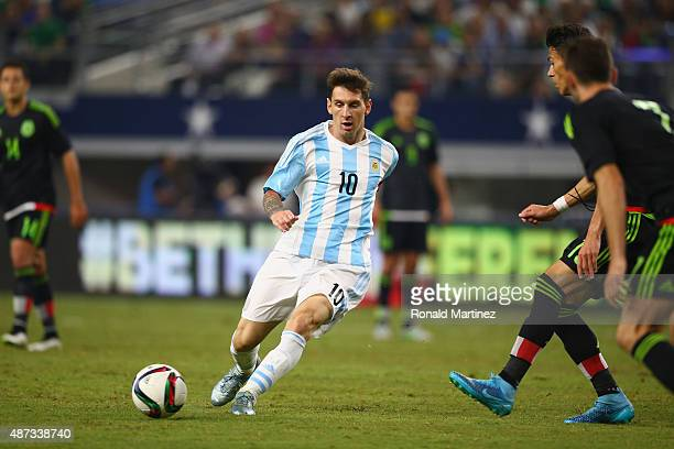 Lionel Messi of Argentina dribbles the ball against Mexico during a international friendly in the second half at ATT Stadium on September 8 2015 in...