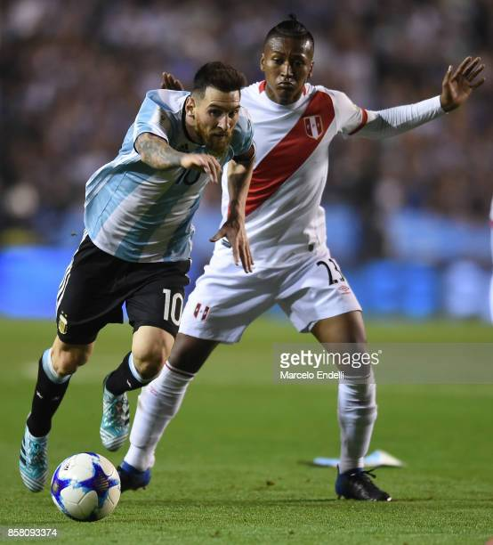 Lionel Messi of Argentina fights for ball with Pedro Aquino of Peru during a match between Argentina and Peru as part of FIFA 2018 World Cup...