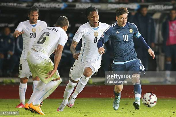 Lionel Messi of Argentina fights for the ball with Abel Hernandez of Uruguay during the 2015 Copa America Chile Group B match between Argentina and...