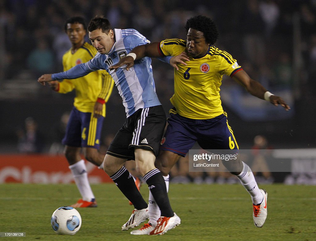 <a gi-track='captionPersonalityLinkClicked' href=/galleries/search?phrase=Lionel+Messi&family=editorial&specificpeople=453305 ng-click='$event.stopPropagation()'>Lionel Messi</a> of Argentina fights for the ball with Carlos Sanchez of Colombia during a match between Argentina and Colombia as part of the 13th round of the South American Qualifiers for the FIFA's World Cup Brazil 2014 at the Monumental Stadium on June 07, 2013 in Buenos Aires, Argentina.