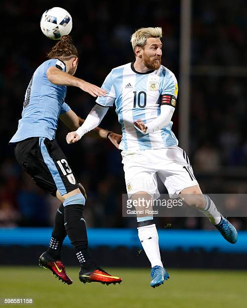 Lionel Messi of Argentina fights for the ball with Gaston Silva of Uruguay during a match between Argentina and Uruguay as part of FIFA 2018 World...
