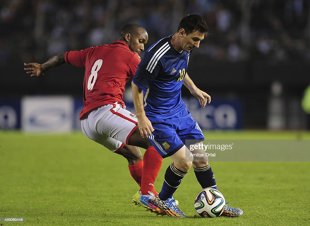 <a gi-track='captionPersonalityLinkClicked' href=/galleries/search?phrase=Lionel+Messi&family=editorial&specificpeople=453305 ng-click='$event.stopPropagation()'>Lionel Messi</a> of Argentina fights for the ball with <a gi-track='captionPersonalityLinkClicked' href=/galleries/search?phrase=Khaleem+Hyland&family=editorial&specificpeople=5366394 ng-click='$event.stopPropagation()'>Khaleem Hyland</a> od Trinidad & Tobago during a FIFA friendly match between Argentina and Trinidad & Tobago at Monumental Antonio Vespucio Liberti Stadium on June 4, 2014 in Buenos Aires, Argentina.