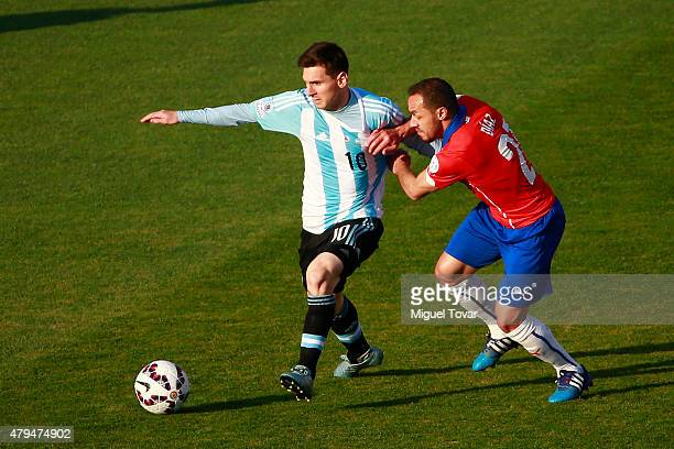 Lionel Messi of Argentina fights for the ball with Marcelo Diaz of Chile during the 2015 Copa America Chile Final match between Chile and Argentina...