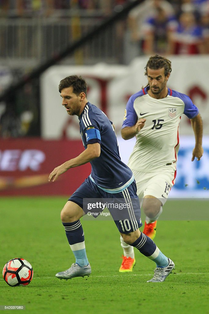 <a gi-track='captionPersonalityLinkClicked' href=/galleries/search?phrase=Lionel+Messi&family=editorial&specificpeople=453305 ng-click='$event.stopPropagation()'>Lionel Messi</a> of Argentina fights for the ball with <a gi-track='captionPersonalityLinkClicked' href=/galleries/search?phrase=Perry+Kitchen&family=editorial&specificpeople=5005041 ng-click='$event.stopPropagation()'>Perry Kitchen</a> of United States during the Semifinal match between United States and Argentina at NRG Stadium as part of Copa America Centenario US 2016 on June 21, 2016 in Houston, Texas, US.
