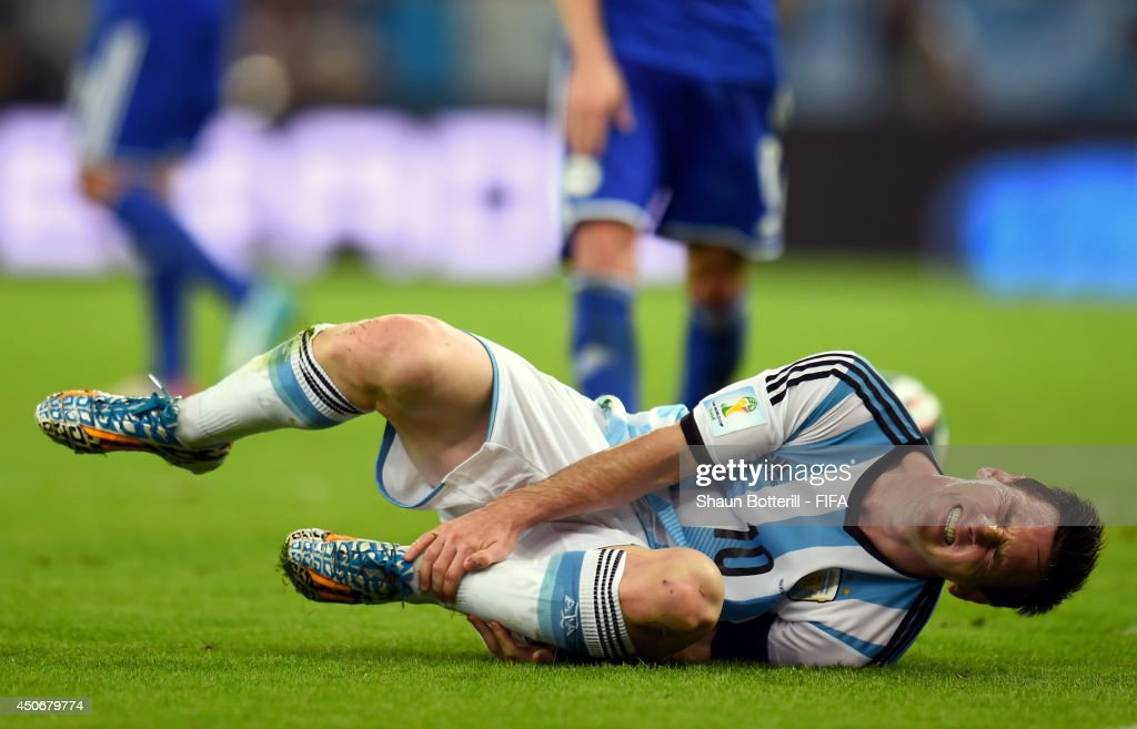 Lionel Messi of Argentina goes down holding his ankle during the 2014 FIFA World Cup Brazil Group F match between Argentina and Bosnia-Herzegovina at Maracana on June 15, 2014 in Rio de Janeiro, Brazil.