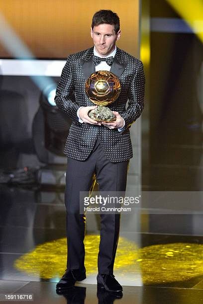 Lionel Messi of Argentina holds the trophy after winning the FIFA Ballon d'Or for a fourth consecutive time during the FIFA Ballon d'Or Gala 2013 at...