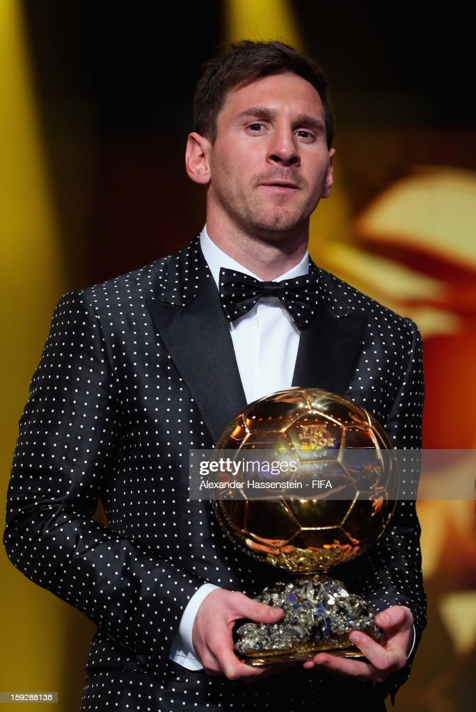 <a gi-track='captionPersonalityLinkClicked' href=/galleries/search?phrase=Lionel+Messi&family=editorial&specificpeople=453305 ng-click='$event.stopPropagation()'>Lionel Messi</a> of Argentina holds the trophy alloft after winning the FIFA Ballon d'Or for a fourth consecutive time during FIFA Ballon d'Or Gala 2012 at the Kongresshaus on January 7, 2013 in Zurich, Switzerland.