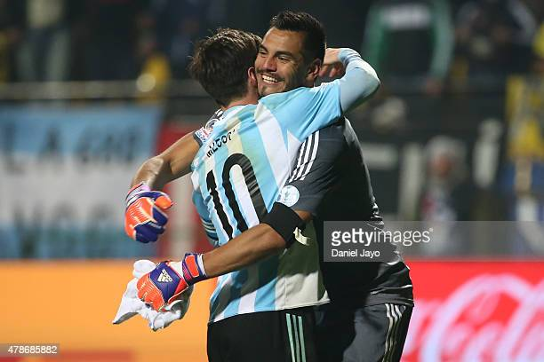 Lionel Messi of Argentina hugs his teammate Sergio Romero after the 2015 Copa America Chile quarter final match between Argentina and Colombia at...