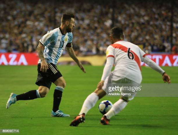 Lionel Messi of Argentina in action against Miguel Trauco of Peru during the 2018 FIFA World Cup Qualification match between Argentina and Peru at...