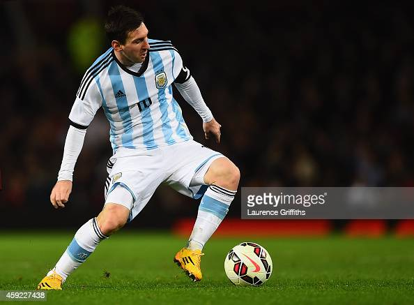 Lionel Messi of Argentina in action during the International Friendly match between Argentina and Portugal at Old Trafford on November 18 2014 in...