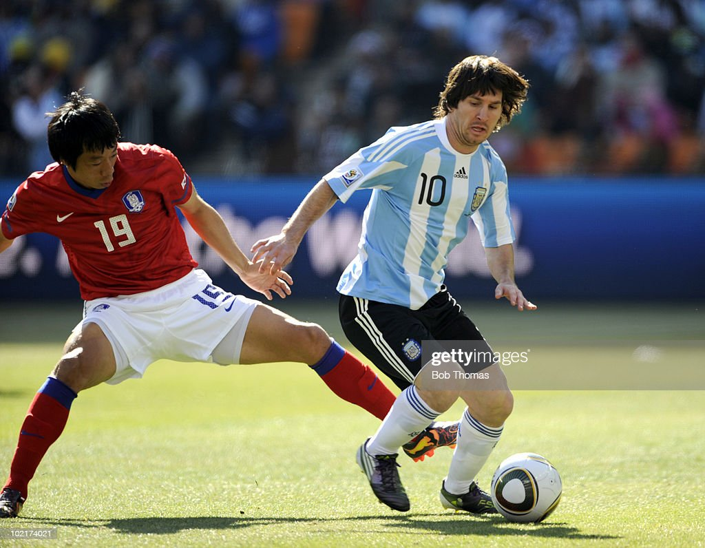 <a gi-track='captionPersonalityLinkClicked' href=/galleries/search?phrase=Lionel+Messi&family=editorial&specificpeople=453305 ng-click='$event.stopPropagation()'>Lionel Messi</a> (R) of Argentina is challenged by <a gi-track='captionPersonalityLinkClicked' href=/galleries/search?phrase=Yeom+Ki-Hun&family=editorial&specificpeople=3986014 ng-click='$event.stopPropagation()'>Yeom Ki-Hun</a> of South Korea during the 2010 FIFA World Cup South Africa Group B match between Argentina and South Korea at Soccer City Stadium on June 17, 2010 in Johannesburg, South Africa. Argentina won the match 4-1.