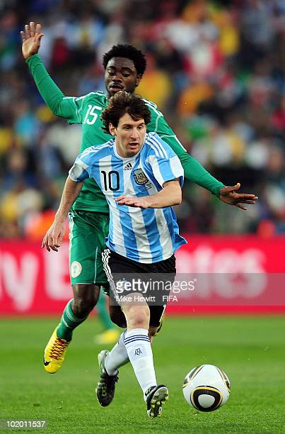 Lionel Messi of Argentina is chased by Ayodele Adeleye of Nigeria during the 2010 FIFA World Cup South Africa Group B match between Argentina and...