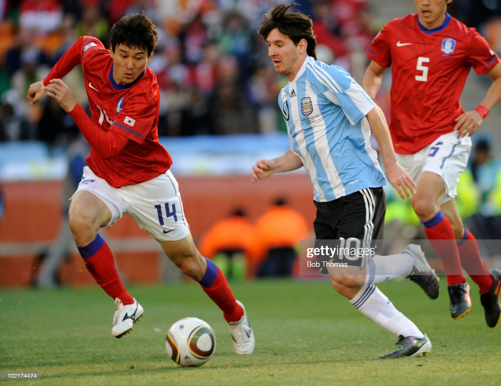 <a gi-track='captionPersonalityLinkClicked' href=/galleries/search?phrase=Lionel+Messi&family=editorial&specificpeople=453305 ng-click='$event.stopPropagation()'>Lionel Messi</a> (C) of Argentina is chased by <a gi-track='captionPersonalityLinkClicked' href=/galleries/search?phrase=Lee+Jung-Soo&family=editorial&specificpeople=5040502 ng-click='$event.stopPropagation()'>Lee Jung-Soo</a> of South Korea during the 2010 FIFA World Cup South Africa Group B match between Argentina and South Korea at Soccer City Stadium on June 17, 2010 in Johannesburg, South Africa. Argentina won the match 4-1.