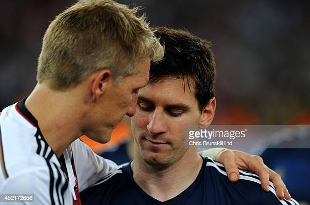 Lionel Messi of Argentina is consoled by Bastian Schweinsteiger of Germany following the 2014 World Cup Final match between Germany and Argentina at...