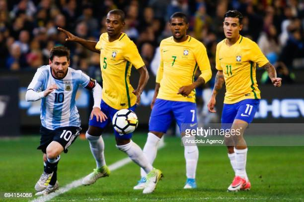 Lionel Messi of Argentina is contested by three Brazilian players during a friendly football international between Argentina and Brazil at the...