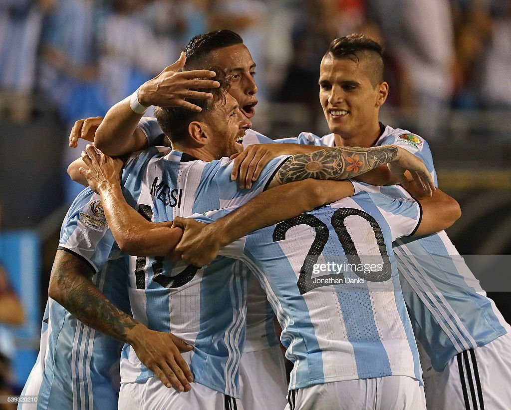 <a gi-track='captionPersonalityLinkClicked' href=/galleries/search?phrase=Lionel+Messi&family=editorial&specificpeople=453305 ng-click='$event.stopPropagation()'>Lionel Messi</a> #10 of Argentina (center) is hugged by teammates including <a gi-track='captionPersonalityLinkClicked' href=/galleries/search?phrase=Ever+Banega&family=editorial&specificpeople=4100796 ng-click='$event.stopPropagation()'>Ever Banega</a> #19 , <a gi-track='captionPersonalityLinkClicked' href=/galleries/search?phrase=Nicolas+Gaitan&family=editorial&specificpeople=5538639 ng-click='$event.stopPropagation()'>Nicolas Gaitan</a> and <a gi-track='captionPersonalityLinkClicked' href=/galleries/search?phrase=Gabriel+Mercado&family=editorial&specificpeople=4110696 ng-click='$event.stopPropagation()'>Gabriel Mercado</a> #4 after scoring a goal on a penalty kick against Panama during a match in the 2016 Copa America Centenario at Soldier Field on June 10, 2016 in Chicago, Illinois. Argentina defeated Panama 5-0.