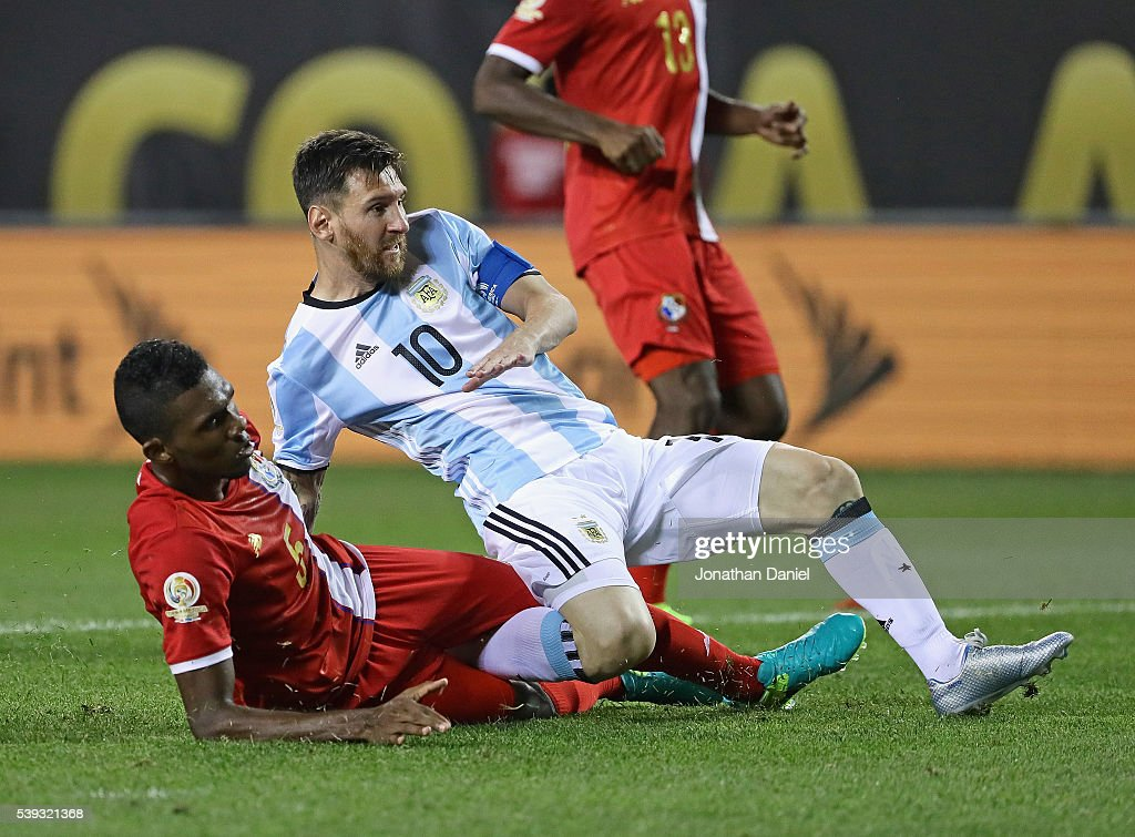 Lionel Messi of Argentina is pulled down by Roderick Miller of Panama after scoring his first goal of the match during the 2016 Copa America...