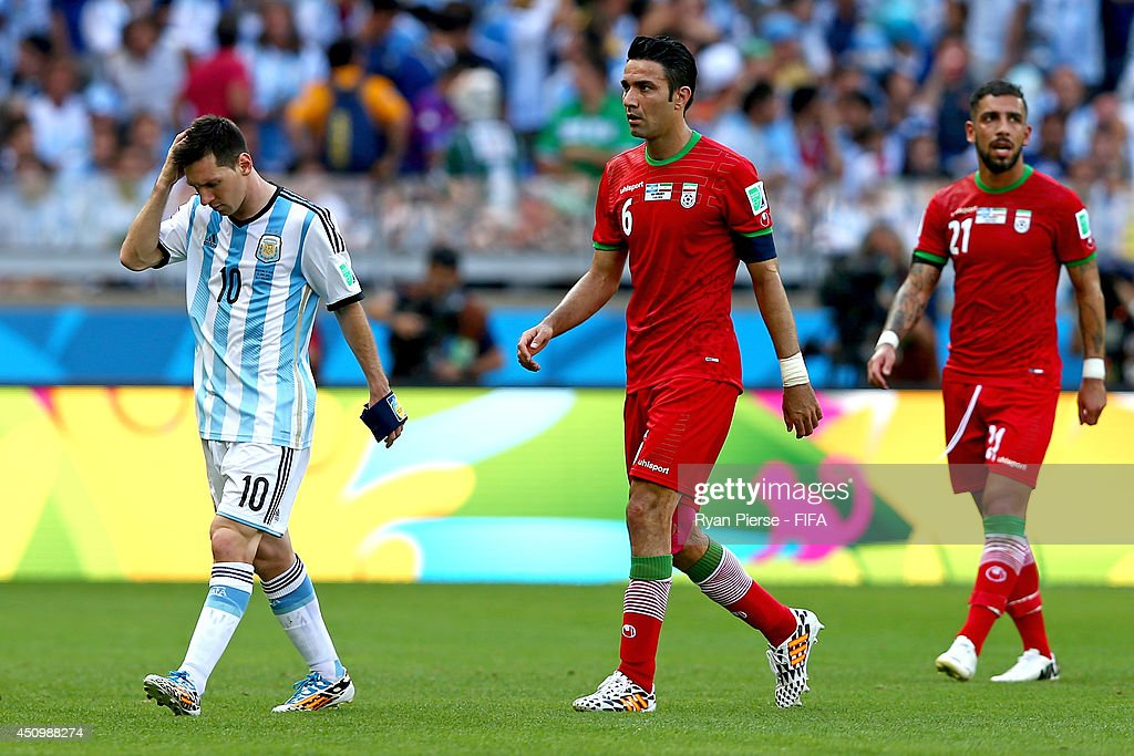 Lionel Messi of Argentina, Javad Nekounam and Ashkan Dejagah of Iran walk off the pitch after the first half during the 2014 FIFA World Cup Brazil Group F match between Argentina and Iran at Estadio Mineirao on June 21, 2014 in Belo Horizonte, Brazil.