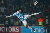 Lionel Messi of Argentina jumps to control the ball during the 2015 Copa America Chile Semi Final match between Argentina and Paraguay at Ester Roa...