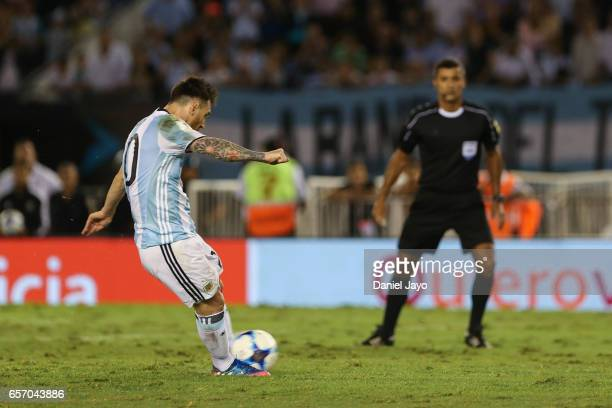 Lionel Messi of Argentina kicks a penalty to score the first goal during a match between Argentina and Chile as part of FIFA 2018 World Cup...