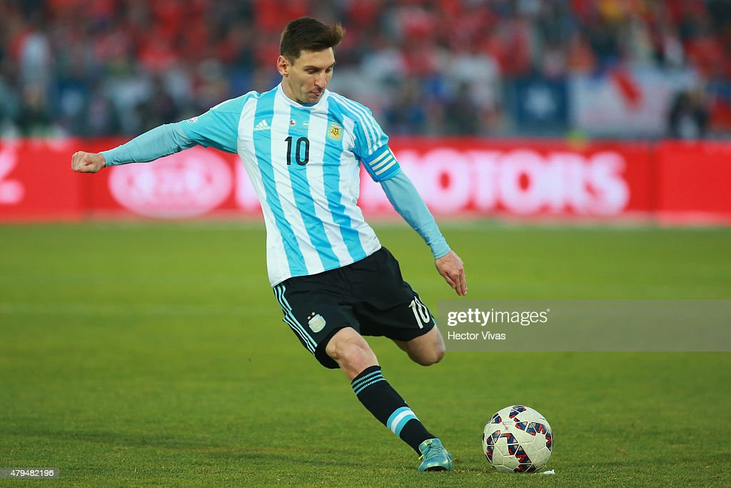 Lionel Messi of Argentina kicks the ball during the 2015 Copa America Chile Final match between Chile and Argentina at Nacional Stadium on July 04...