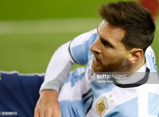 Lionel Messi of Argentina laments after receiving a foul from Yangel Herrera of Venezuela during a match between Argentina and Venezuela as part of...