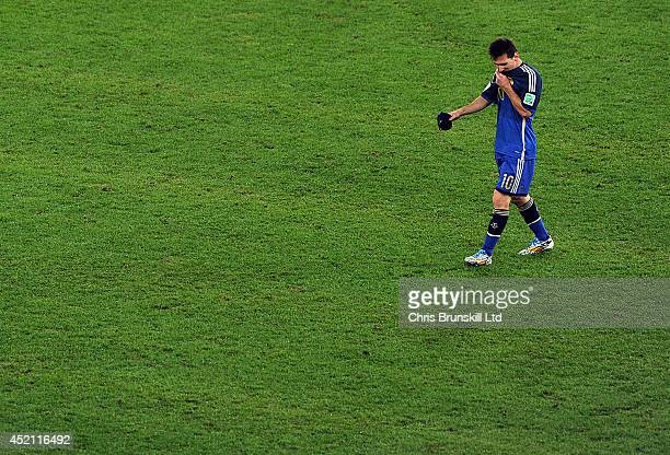 Lionel Messi of Argentina looks dejected during the 2014 World Cup Final match between Germany and Argentina at Maracana Stadium on July 13 2014 in...