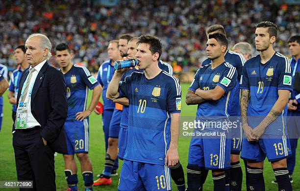 Lionel Messi of Argentina looks dejected next to manager Alejandro Sabella following the 2014 World Cup Final match between Germany and Argentina at...