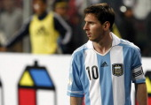 Lionel Messi of Argentina looks on during a match between Peru and Argentina as part of the South American Qualifiers for the FIFA Brazil 2014 World...