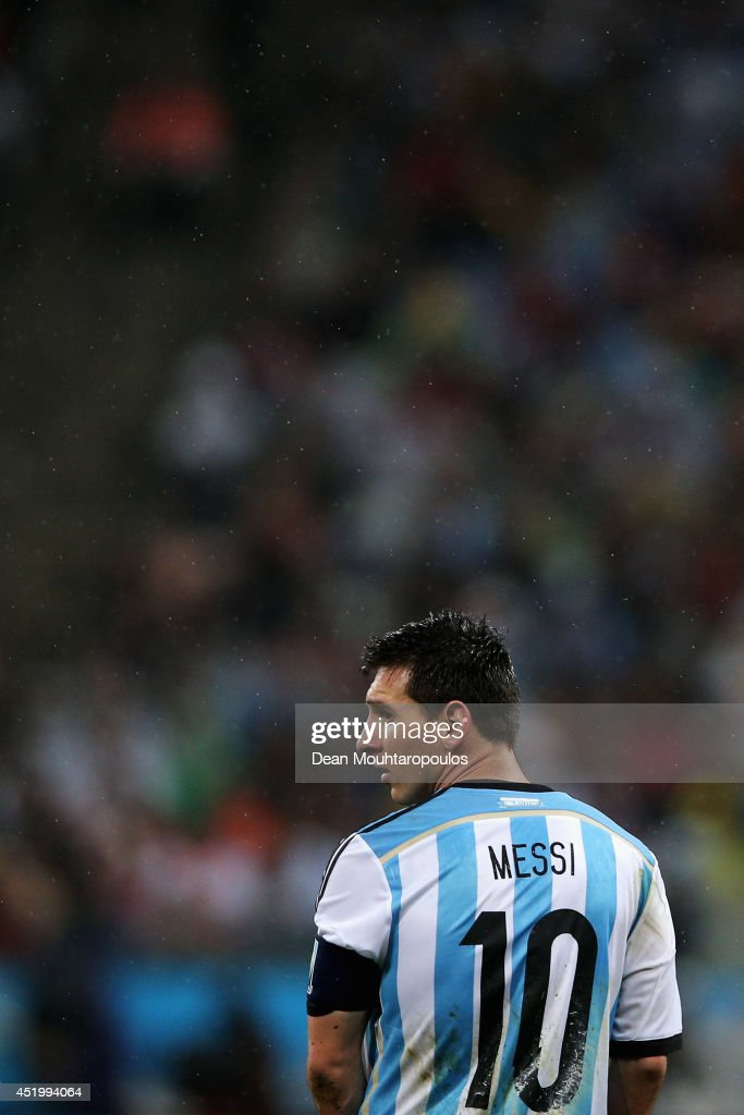 <a gi-track='captionPersonalityLinkClicked' href=/galleries/search?phrase=Lionel+Messi&family=editorial&specificpeople=453305 ng-click='$event.stopPropagation()'>Lionel Messi</a> of Argentina looks on during the 2014 FIFA World Cup Brazil Semi Final match between the Netherlands and Argentina at Arena de Sao Paulo on July 9, 2014 in Sao Paulo, Brazil.