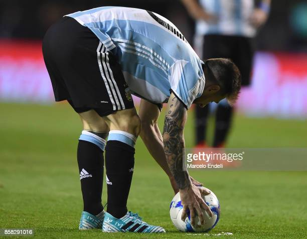 Lionel Messi of Argentina places the ball before a free kick during a match between Argentina and Peru as part of FIFA 2018 World Cup Qualifiers at...