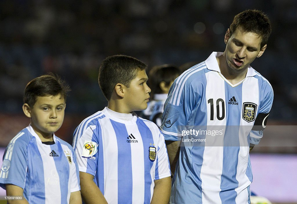Lionel Messi of Argentina pose for a photo with childs prior a friendly soccer match between Argentina and Guatemala at Mateo Flores stadium on June 14 in Guatemala City, Guatemala.