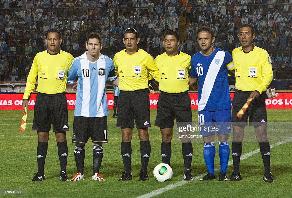 Lionel Messi of Argentina pose for a photo with referees and Guatemala's captain prior a friendly soccer match between Argentina and Guatemala at Mateo Flores stadium on June 14 in Guatemala City, Guatemala.