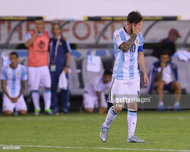 Lionel Messi of Argentina reacts after he missed a penalty kick against Chile during the Copa America Centenario Championship match at MetLife...