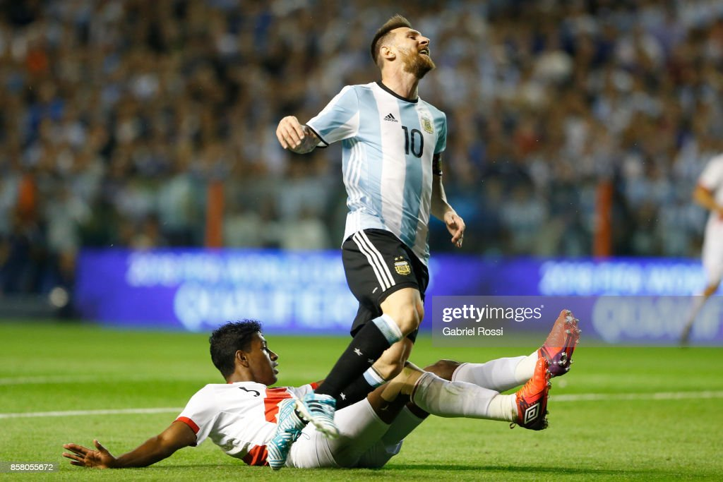 Lionel Messi of Argentina reacts after losing the ball against Miguel Araujo of Peru during a match between Argentina and Peru as part of FIFA 2018 World Cup Qualifiers at Estadio Alberto J. Armando on October 5, 2017 in Buenos Aires, Argentina.