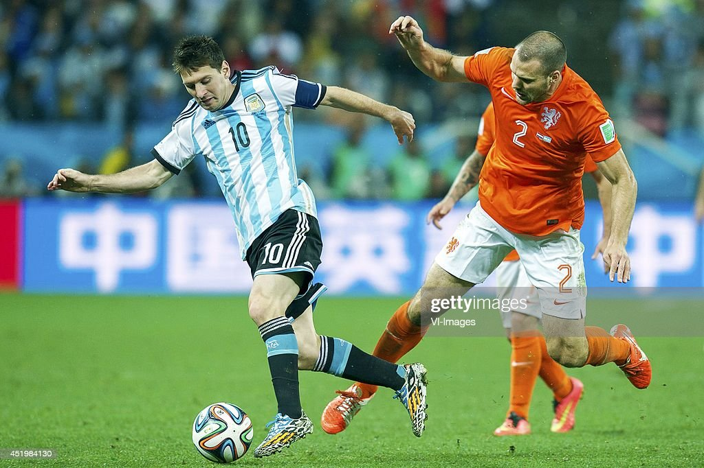Lionel Messi of Argentina, Ron Vlaar of Holland during the match between The Netherlands and Argentina on July 9, 2014 at Arena de Sao Paulo in Sao Paulo, Brazil.