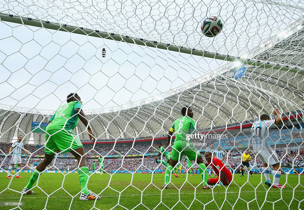 <a gi-track='captionPersonalityLinkClicked' href=/galleries/search?phrase=Lionel+Messi&family=editorial&specificpeople=453305 ng-click='$event.stopPropagation()'>Lionel Messi</a> of Argentina scores his team's first goal past <a gi-track='captionPersonalityLinkClicked' href=/galleries/search?phrase=Vincent+Enyeama&family=editorial&specificpeople=831392 ng-click='$event.stopPropagation()'>Vincent Enyeama</a> of Nigeria during the 2014 FIFA World Cup Brazil Group F match between Nigeria and Argentina at Estadio Beira-Rio on June 25, 2014 in Porto Alegre, Brazil.