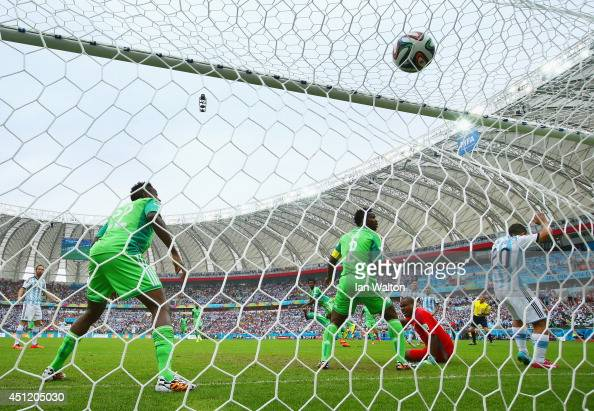 Lionel Messi of Argentina scores his team's first goal past Vincent Enyeama of Nigeria during the 2014 FIFA World Cup Brazil Group F match between...