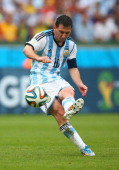Lionel Messi of Argentina scores his team's second goal and his second of the game during the 2014 FIFA World Cup Brazil Group F match between...