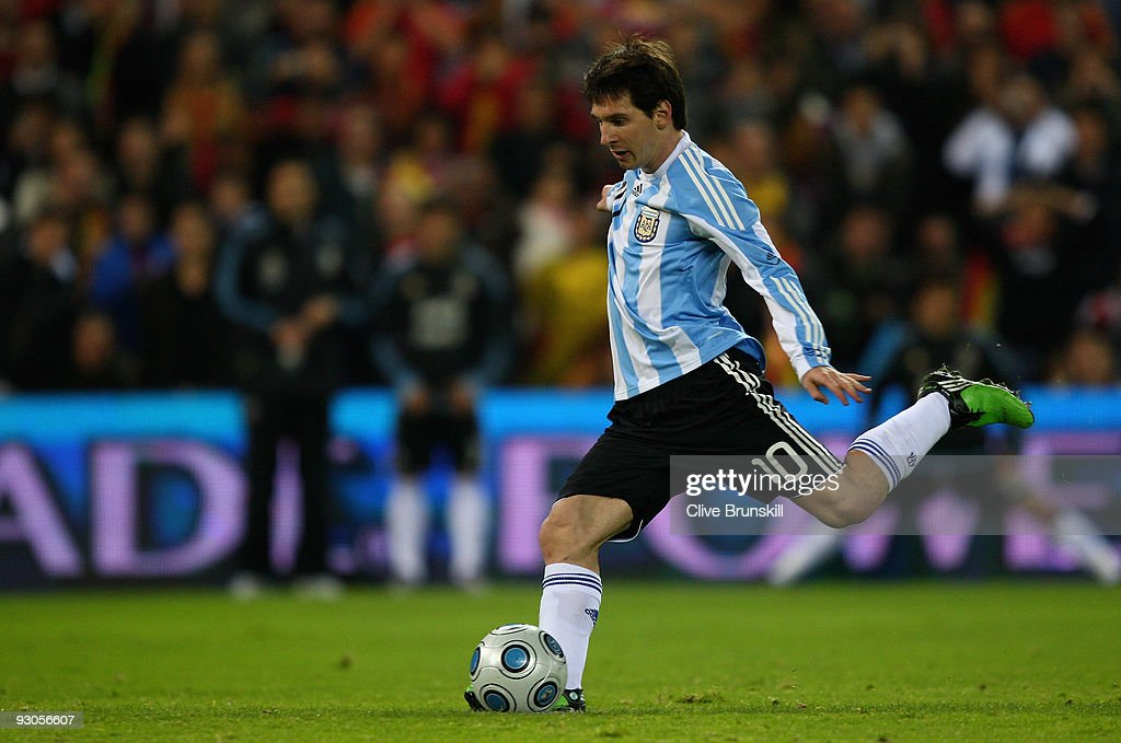 Lionel Messi of Argentina scores the equalizing goal from the penalty spot during the friendly International football match Spain against Argentina at the Vicente Calderon stadium in Madrid, on November 14, 2009 in Madrid, Spain.