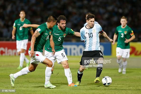 Lionel Messi of Argentina struggles for the ball with Fernando Martelli of Bolivia during a match between Argentina and Bolivia as part of FIFA 2018...