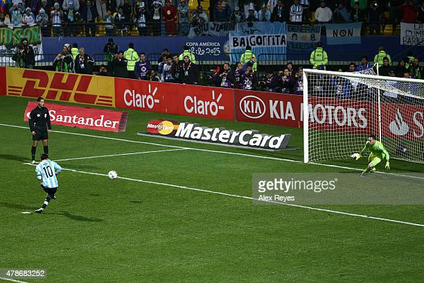 Lionel Messi of Argentina takes the first penalty kick in the penalty shootout during the 2015 Copa America Chile quarter final match between...