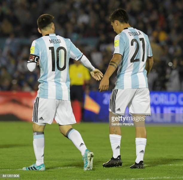 Lionel Messi of Argentina talks whit his teammate Paulo Dybala during a match between Uruguay and Argentina as part of FIFA 2018 World Cup Qualifiers...