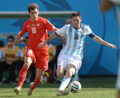Lionel Messi of Argentina vies with Admir Mehmedi of Switzerland during the 2014 FIFA World Cup Brazil Round of 16 match between Argentina and...