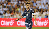Lionel Messi of Argentina walks across the field during their International friendly match against Bolivia at BBVA Compass Stadium on September 4...