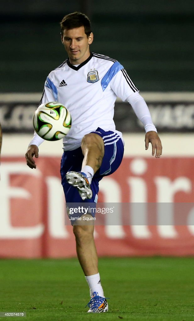 <a gi-track='captionPersonalityLinkClicked' href=/galleries/search?phrase=Lionel+Messi&family=editorial&specificpeople=453305 ng-click='$event.stopPropagation()'>Lionel Messi</a> of Argentina warms up during the Argentina training session, ahead of the 2014 FIFA World Cup Final, at Estadio Sao Januario on July 12, 2014 in Rio de Janeiro, Brazil.