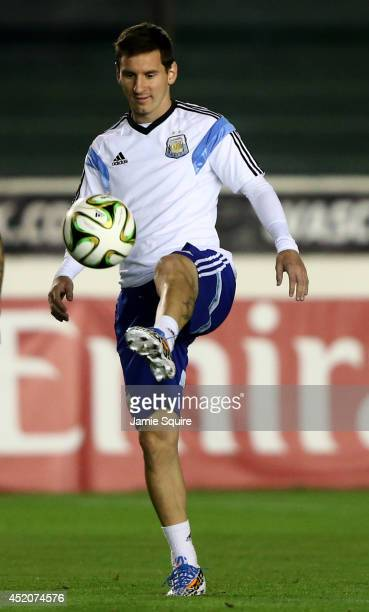 Lionel Messi of Argentina warms up during the Argentina training session ahead of the 2014 FIFA World Cup Final at Estadio Sao Januario on July 12...