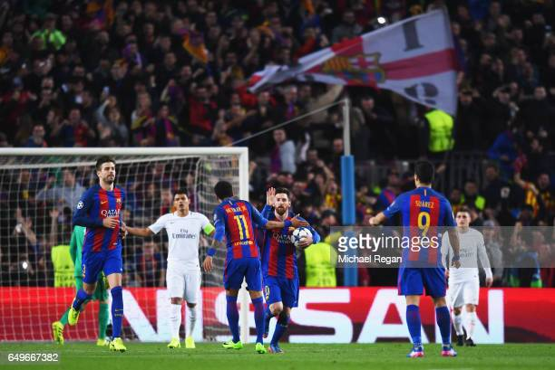 Lionel Messi of Barcelona 10 celebrates as he scores their third goal from a penalty with Neymar during the UEFA Champions League Round of 16 second...